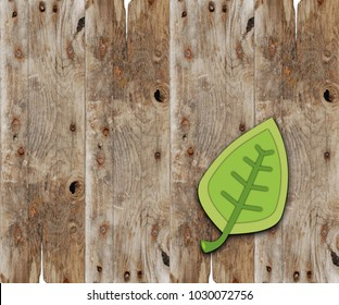 Green cartoon leaf on wood plank background for sign or poster