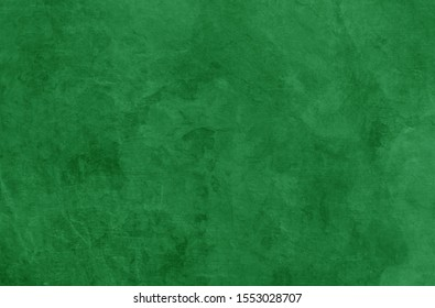 Green Christmas background texture, old vintage textured holiday paper or wallpaper with painted elegant green colors with marbled stone or rock wall