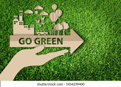 Green city. Paper art style of eco on green grass background. Save the earth.