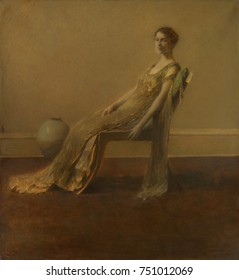 GREEN AND GOLD, by Thomas Wilmer Dewing, 1917, American painting, oil on canvas. A slouching elegantly dressed women sits alone in a spare interior depicted in soft focus with deft impressionist paint