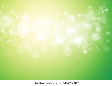 Green and Gold glitter sparkles rays lights bokeh Festive Elegant abstract background.