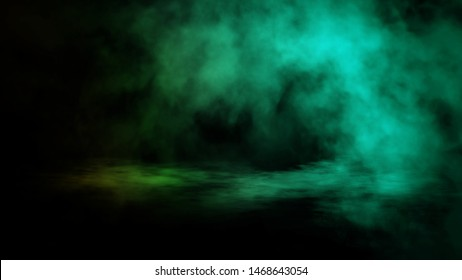 Green gradient smoke on the floor . Isolated background . Misty fog effect texture overlays for text or space.