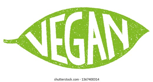 Green leaf with rubber stamp effect and hand lettering of the text vegan for labels.