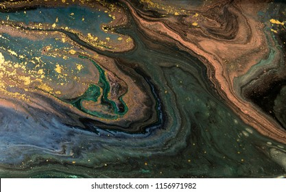 Green marble abstract acrylic background. Marbling artwork texture. Agate ripple pattern. Gold powder.