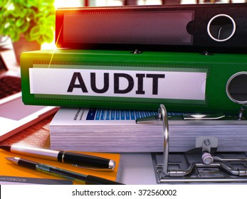 Green Office Folder with Inscription Audit on Office Desktop with Office Supplies and Modern Laptop. Audit Business Concept on Blurred Background. Audit - Toned Image. 3D
