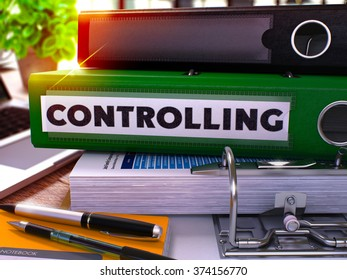 Green Office Folder with Inscription Controlling on Office Desktop with Office Supplies and Modern Laptop. Controlling Business Concept on Blurred Background. Controlling - Toned Image. 3D