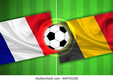green Soccer / Football field with stripes and flags of france - belgium, and ball.