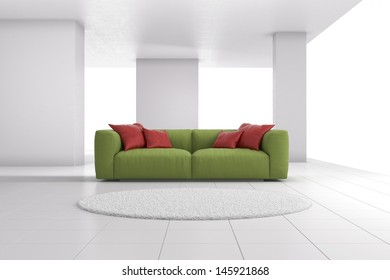 Green sofa in bright room with red cushions