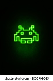 Green space invader neon sign