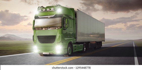 Green truck with a trailer driving on a remote highway through a landscape at dusk