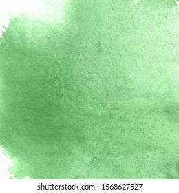 Green watercolor paint paper background texture.