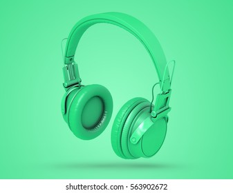 Green wireless headphones on green background with shadow. Musical background with audio green headphones. 3d Illustration