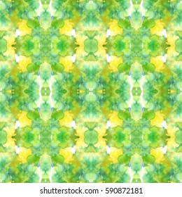 Green and yellow abstract watercolor mirror pattern.