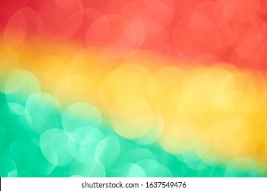 Green yellow red bokeh effect abstract background. Colored circles reggae rasta backdrop, jamaica pattern