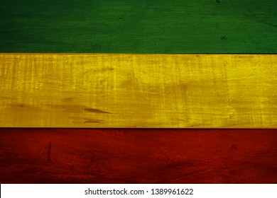 Green yellow red on old wood wall texture,Reggae background concept