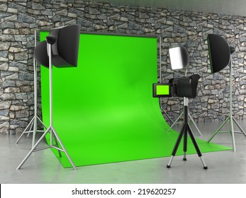 Greenscreen studio setup with lights and lightbox.