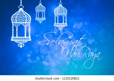 Greeting in Malaysian for Islamic Holidays with  lanterns on blue background
