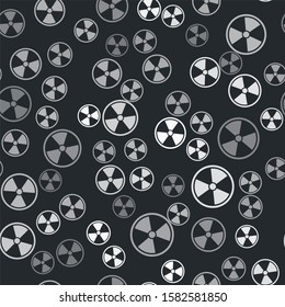 Grey Radioactive icon isolated seamless pattern on black background. Radioactive toxic symbol. Radiation Hazard sign.