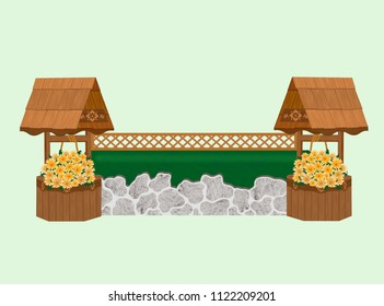 Grey stone wall and green roll-top coop hunter horse show jump with trellis top rail, and decorative wooden wishing wells with yellow and orange hanging flowers.