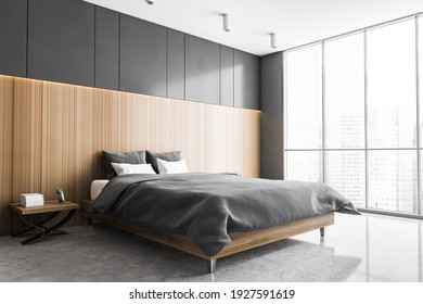 Grey and wooden sleeping room, bed on grey marble floor, side view. Minimalist design of bedroom with wardrobe and windows with city view, 3D rendering no people
