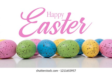 A group of blue Easter Eggs with speckles on a white background