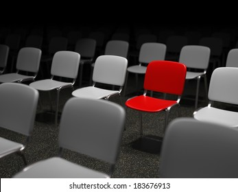 Group of chairs with a red chair standing out symbol for uniqueness