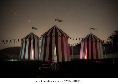 Group of circus tents on green field 3d illustration