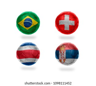 group E . realistic football balls with national flags of brazil, switzerland, costa rica, serbia. soccer teams. 3D illustration