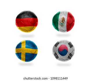 group F . realistic football balls with national flags of germany, mexico, sweden, south korea. soccer teams. 3D illustration