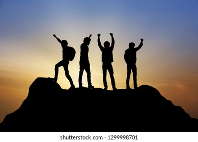 Group of people on peak mountain climbing helping team work with sunset background , travel trekking success business  winner concept