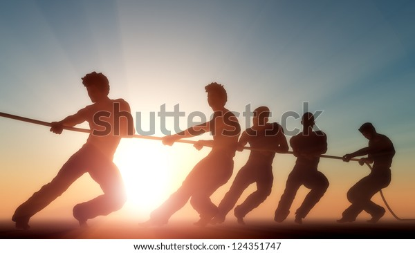 Group of people pulling the rope in the sunlight.