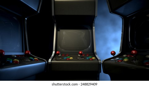 A group of vintage unbranded arcade games with a joysticks and buttons and a blank screen huddled facing each other on a dark ominous background with copy space
