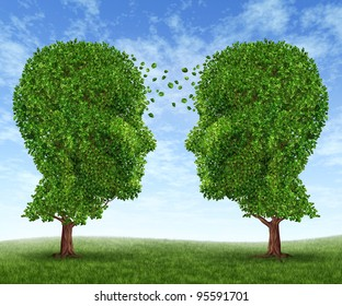 Growing partnership and teamwork communication in business with two trees in the shape of human heads on a blue sky with leaves exchanging from one face to the other as a concept of cooperation.