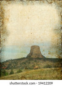 A grunge background of the Devil's Tower in Wyoming.