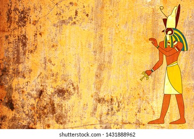Grunge background with Egyptian god Horus image and old stucco texture of yellow color. Mock up template. Copy space for text