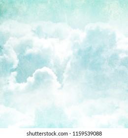 Grunge background with texture of old soiled paper and white clouds