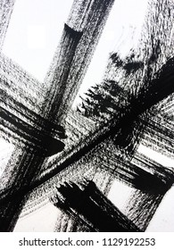 Grunge dry brush technique using black  paint. Abstract black and white ink background