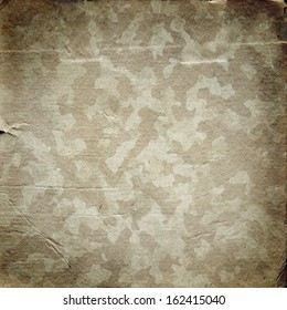 Grunge military background. Camouflage pattern on a paper texture