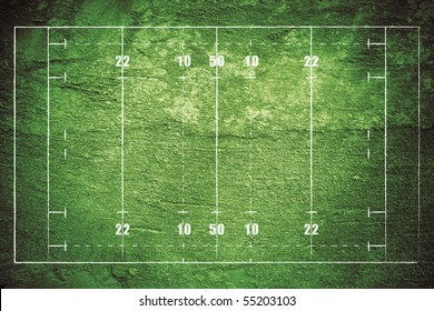 Grunge rugby field with chalk drawn lines.