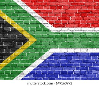 Grunge South Africa flag on brick wall
