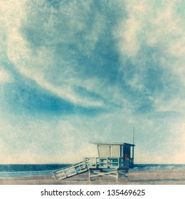 Grunge style beach background with lifeguard tower