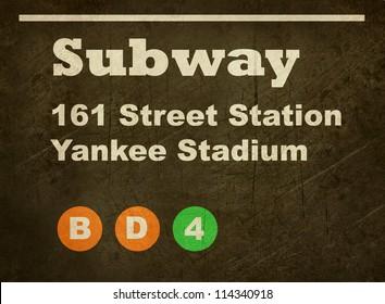Grunge Yankee Stadium subway train sign isolated on black background.