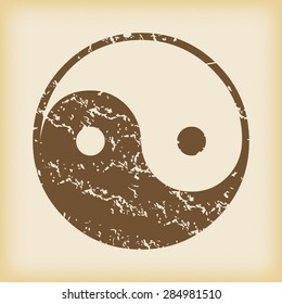 Grungy brown icon with ying yang symbol, on beige background