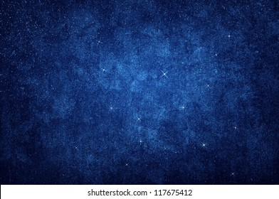 grungy glittering star on the night sky