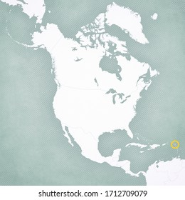 Guadeloupe on the map of North America with softly striped vintage background.