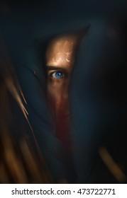 Half face of mystery man