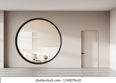 Hall of modern business center with beige walls, concrete floor, comfortable meeting room with white conference table and chairs seen through round window. 3d rendering
