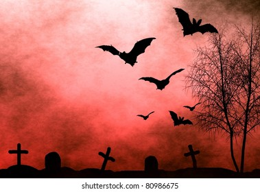 Halloween background. Bloody foggy night at graveyard with bats flying