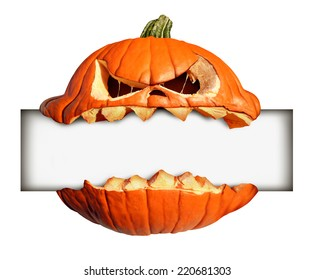 Halloween blank sign as a pumpkin character biting into a blank banner with jack o lantern teeth as an advertising and marketing message with a scary expression isolated on a white background.