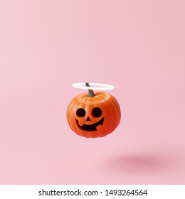 Halloween pumpkin with halo angel on pastel pink background. Creative idea. Minimal concept. 3d rendering